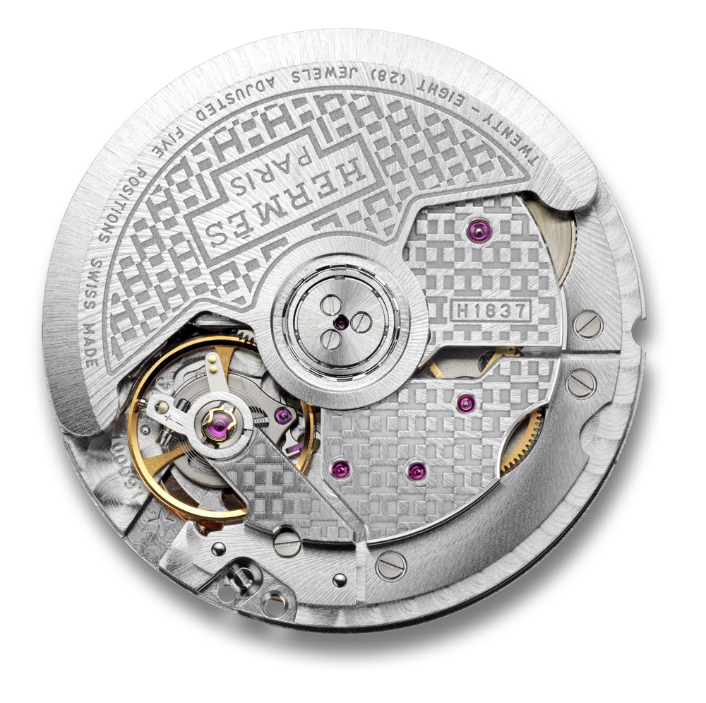 "The sprinkled ""H"" letters motif elegantly adorns the satin-brushed oscillating movement and stretches across the movement's bridges."