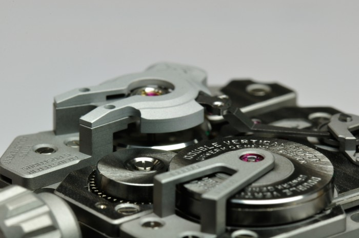 The balance of the URWERK EMC movement is seen in the rear of the image