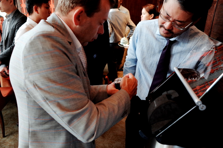 President of BUBEN&ZORWEG, Christian Zorweg demonstrates the Time Mover – HandWound at their exclusive boutique in ION Singapore
