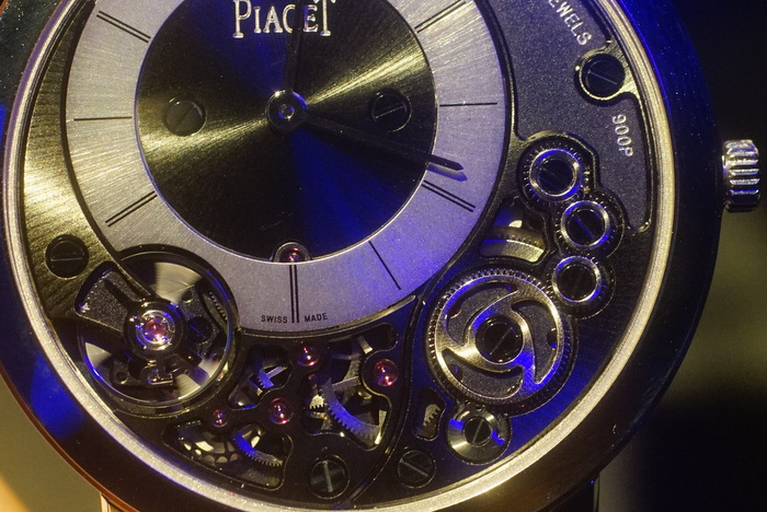 Close up of the visible gear train on the dial.