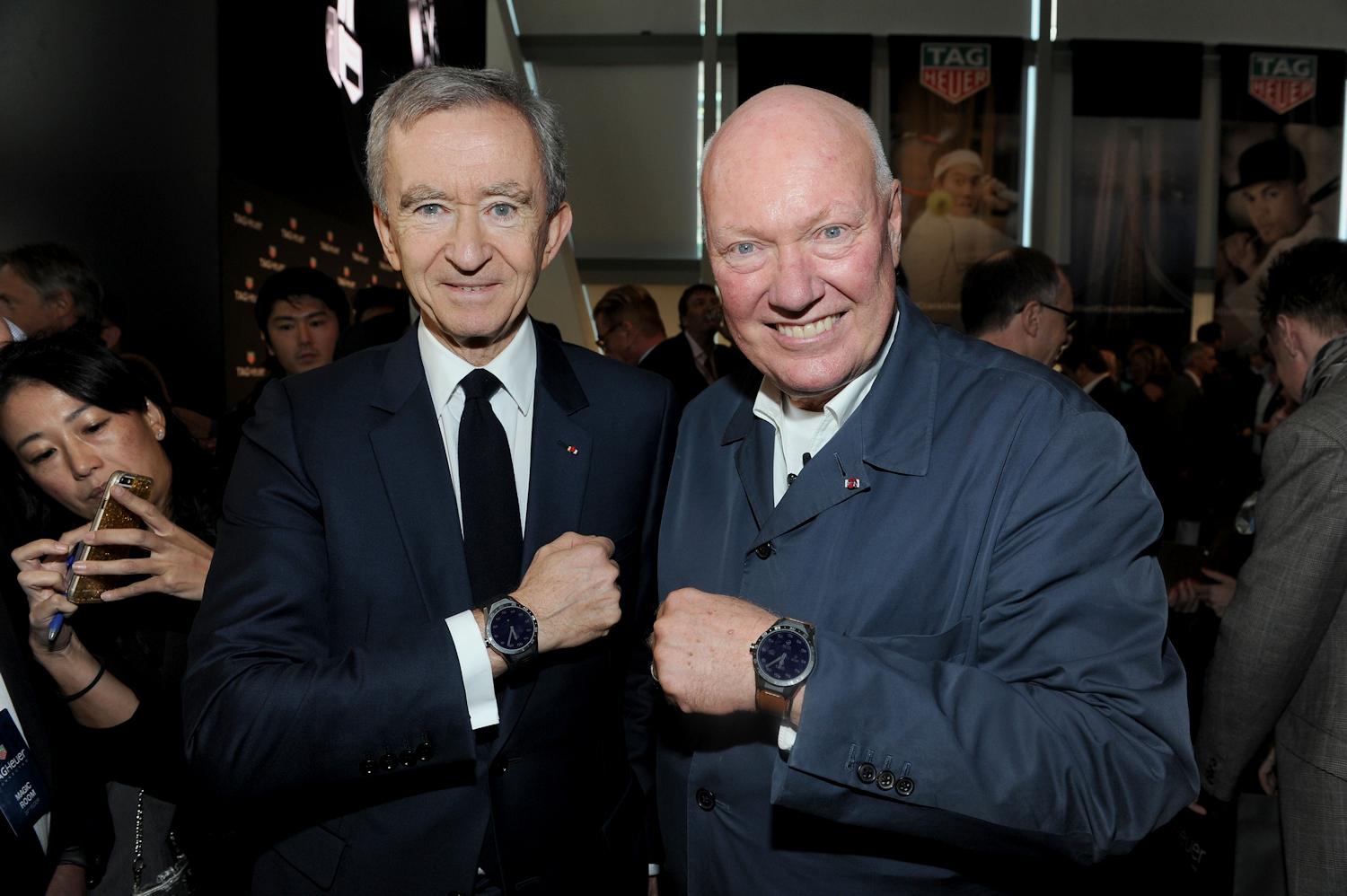 Chairman and CEO of LVMH Bernard Arnault (left) poses with Jean-Claude Biver for a traditional wrist shot.
