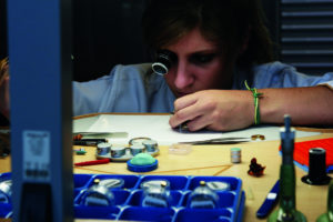 A young watchmaker assembling a complication