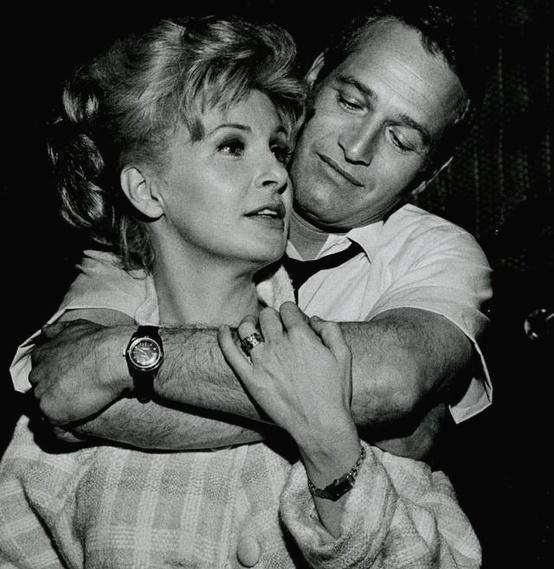 Paul Newman shares a moment with his wife Joanne Woodward