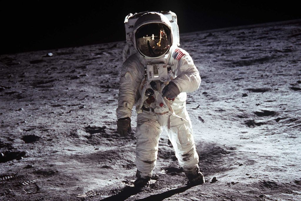 Aldrin walks on the surface of the Moon, the lunar module Eagle and fellow astronaut Neil Armstrong are reflected in his visor and the Speedmaster is visible on his right wrist. (Image: NASA.gov)