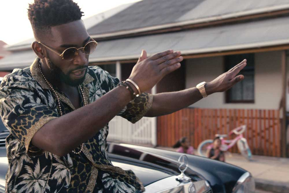 Tempah in his music video for the song Girls Like Ft. Zara Larsson, wearing his rose gold AP.