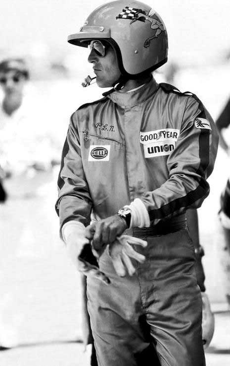 Paul Newman in his racing gear, his exotic dial 6239 clearly visible on his wrist