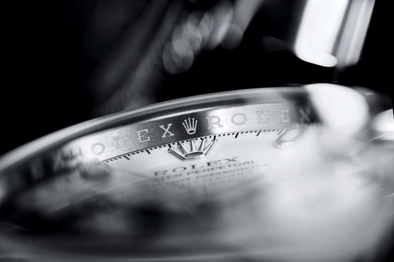The Rolex name and logo on the watch