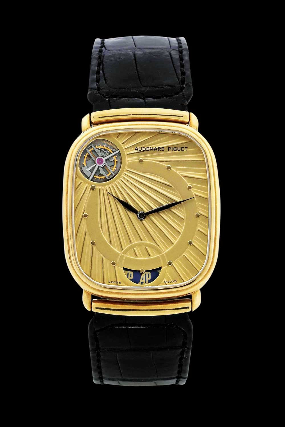 "The centrepiece of the watch's dial is the tourbillon aperture – a familiar sight today, but a rarity in the 1980s. The tourbillon represents the sun with the rays crossing the dial from this point. Inspired by Egyptian carvings, the watch became known as ""Ra"" – the sun god"
