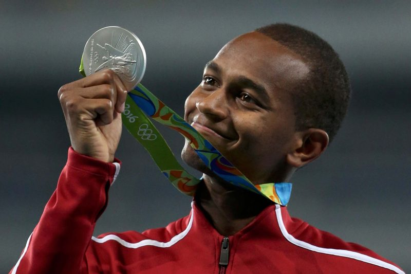 2016 Rio Olympics - Men's High Jump Victory Ceremony - Olympic Stadium - Rio de Janeiro, Brazil - 17/08/2016.   Mutaz Essa Barshim of Qatar  poses with his silver medal. REUTERS/Edgard Garrido