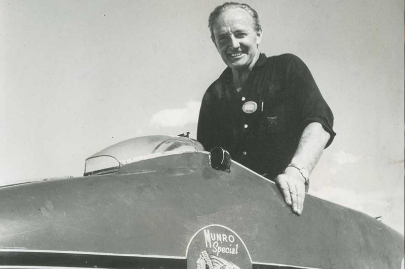 Burt Munro seated in the modified Munro Special