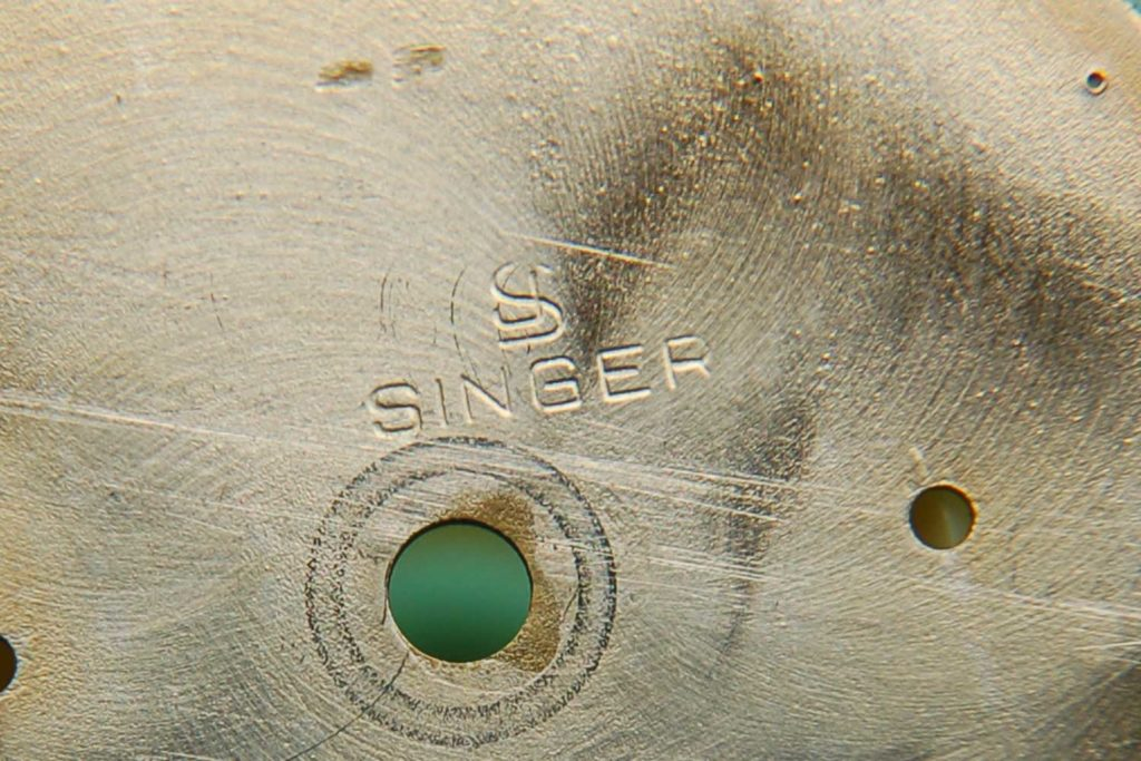 The Singer stamp on the back of the yellow gold 14K ref. 6241 Paul Newman Daytona
