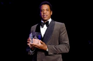 Jay-Z accepts the President's Merit Award onstage during the Clive Davis and Recording Academy Pre-GRAMMY Gala and GRAMMY Salute to Industry Icons Honoring Jay-Z