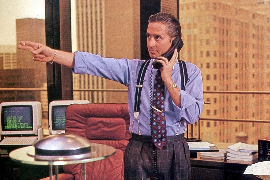 Gordon Gekko wearing his solid yellow gold Cartier Santos