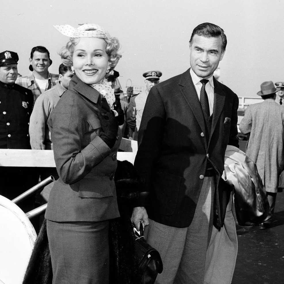 In good company: Porfirio Rubirosa with Zsa Zsa Gábor on the tarmac, circa 1954