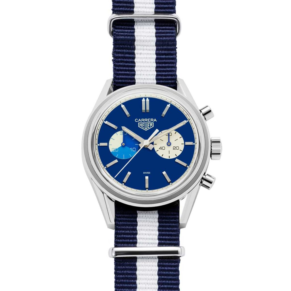The Revolution x TAG Heuer timepiece on blue textile NATO strap with a jaunty white stripe