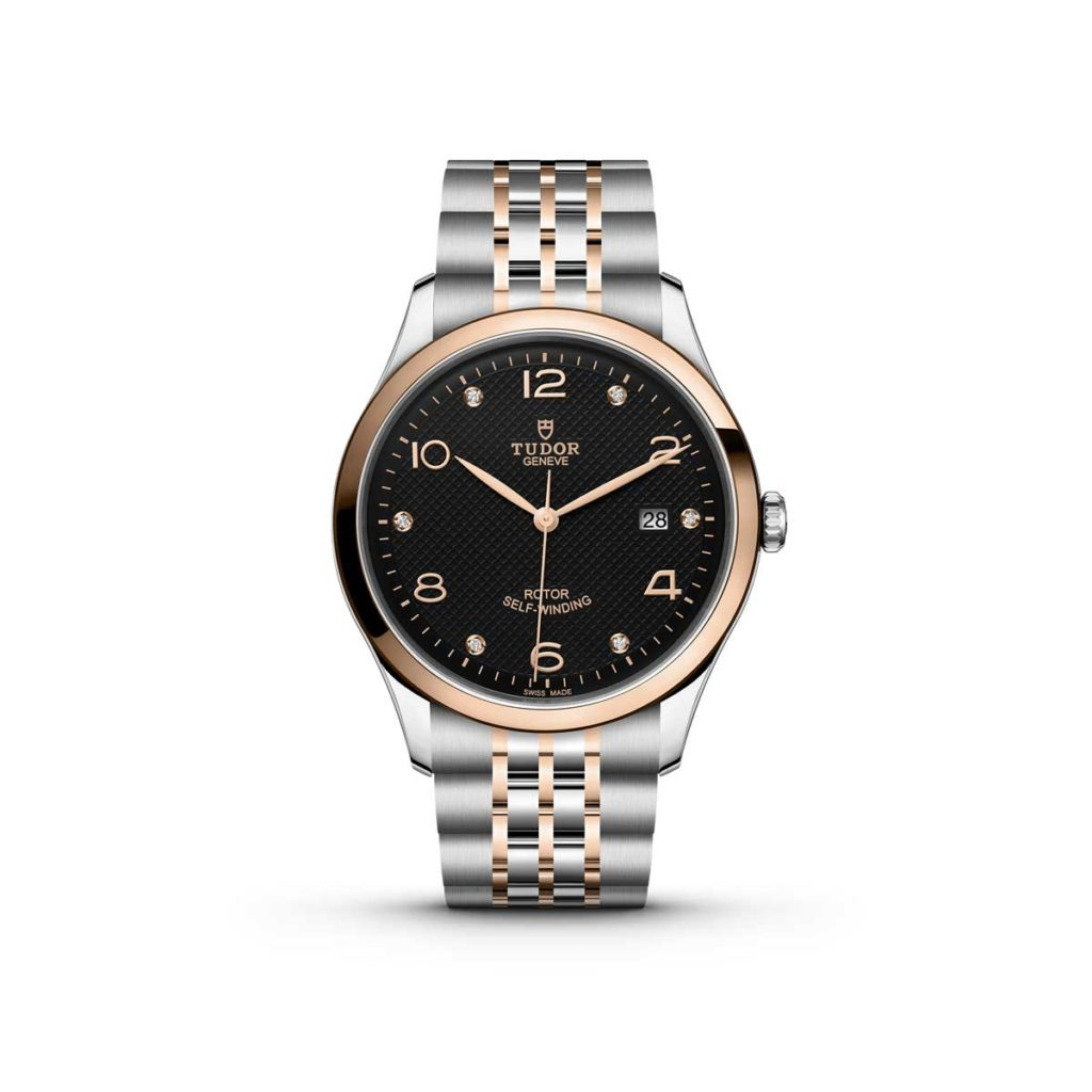 The Tudor 1926 with a 41mm steel case and rose gold bezel; black dial with rose gold and diamond hour markers and hands