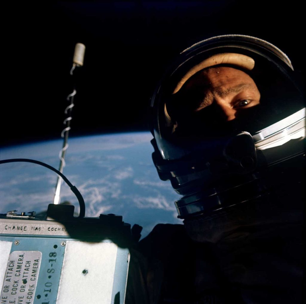 Astronaut Buzz Aldrin, pilot of the Gemini-12 spaceflight snaps a photograph pf himself with the pilot's hatch of the spacecraft open. Note: The camera used was a J.A. Maurer camera which was used to photograph some of his extravehicular activity. (Image: NASA.gov)