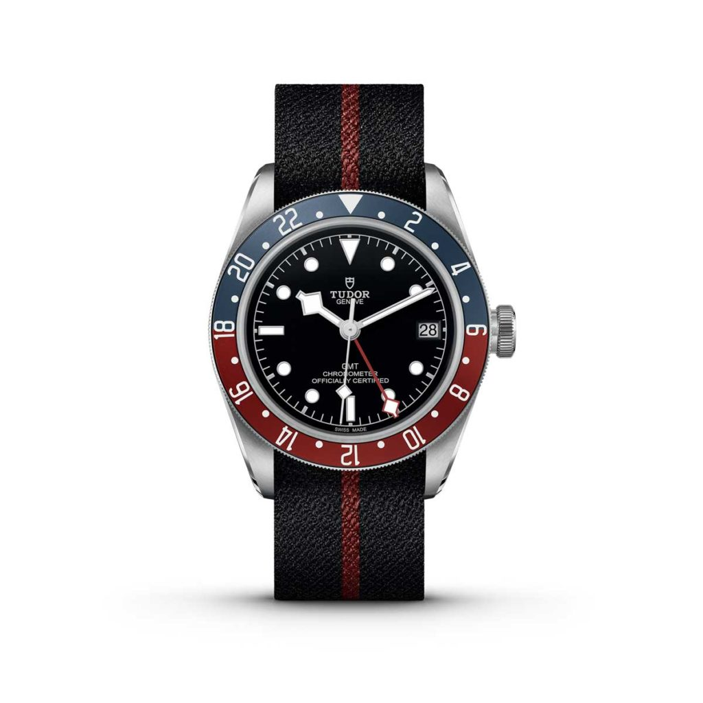 The Tudor Black Bay GMT on a black and burgundy striped fabric strap