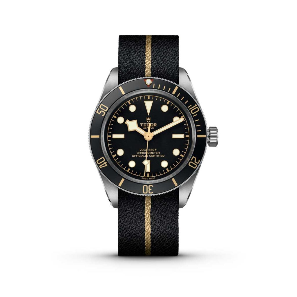 The Black Bay Fifty-Eight on a black fabric strap with a gold-coloured band