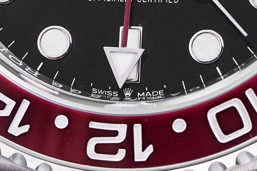 "The crown logo placed in-between ""Swiss Made' on the dial of the 2018 Oystersteel GMT-Master II Ref. 126710 BLRO indicating the use of the new generation caliber 3285 (© Revolution)"