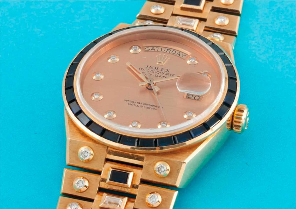 A Rolex Day-Date Oysterquartz ref. 19168 in 18k yellow gold, decorated with diamonds and sapphires; sold on 9 May 2015 for CHF93,750 (Image: phillipswatches.com)