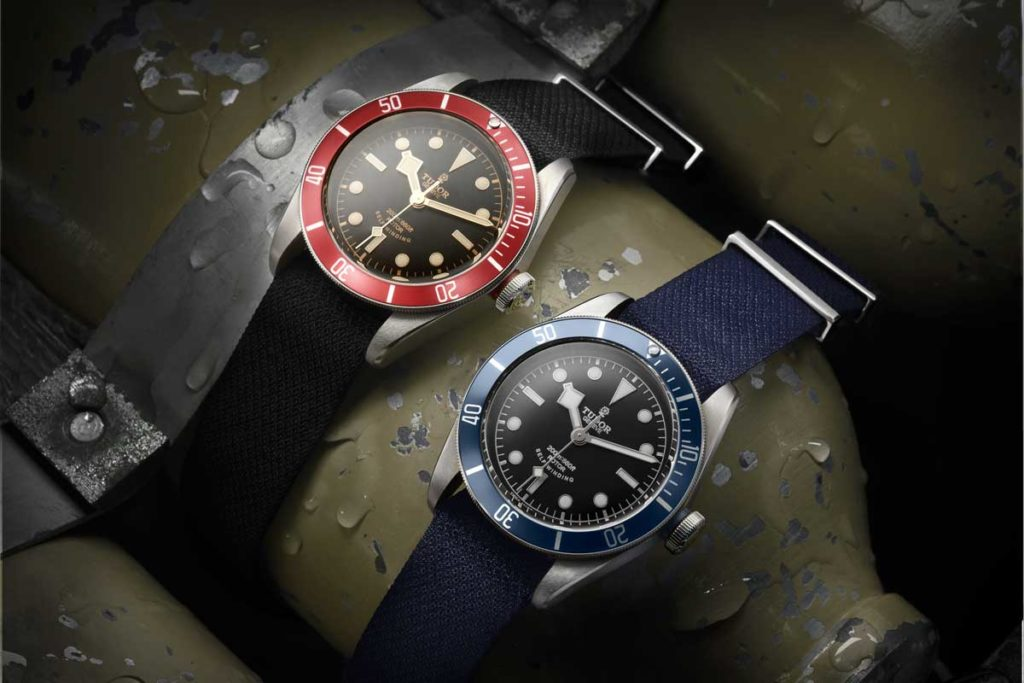 The burgundy Heritage Black Bay next to the blue edition introduced in 2014