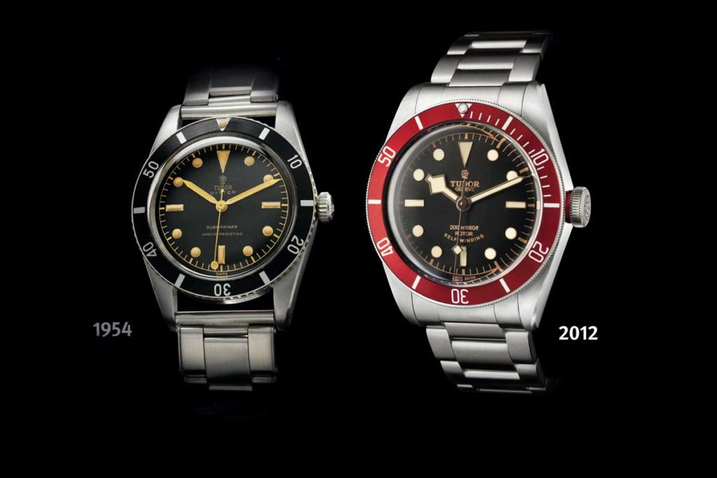 A 1955 Tudor Oyster Submariner ref. 7923 held next to the 2014 version of the burgundy Heritage Black Bay of 2012