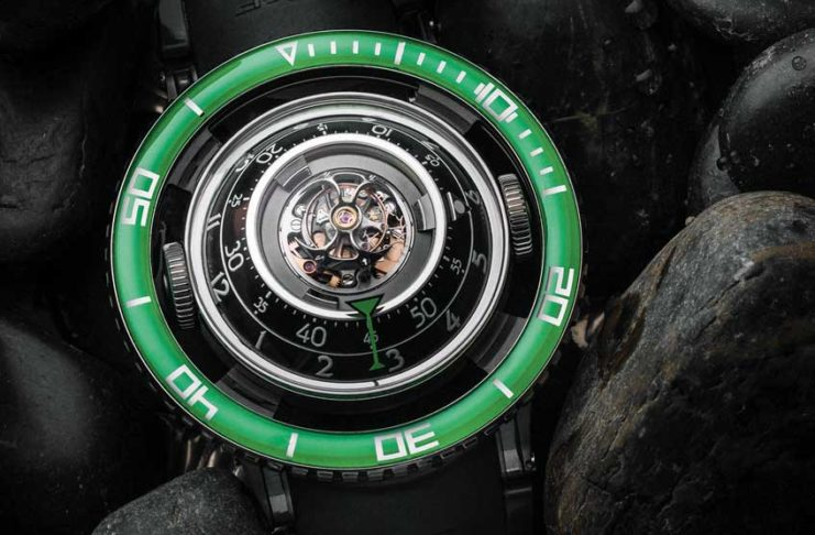 The HM7 Aquapod in titanium with a green sapphire bezel (© Revolution)