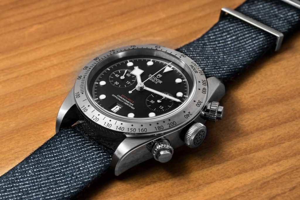 The Black Bay Chronograph on a denim-like fabric strap made by Julien Faure (© Revolution)
