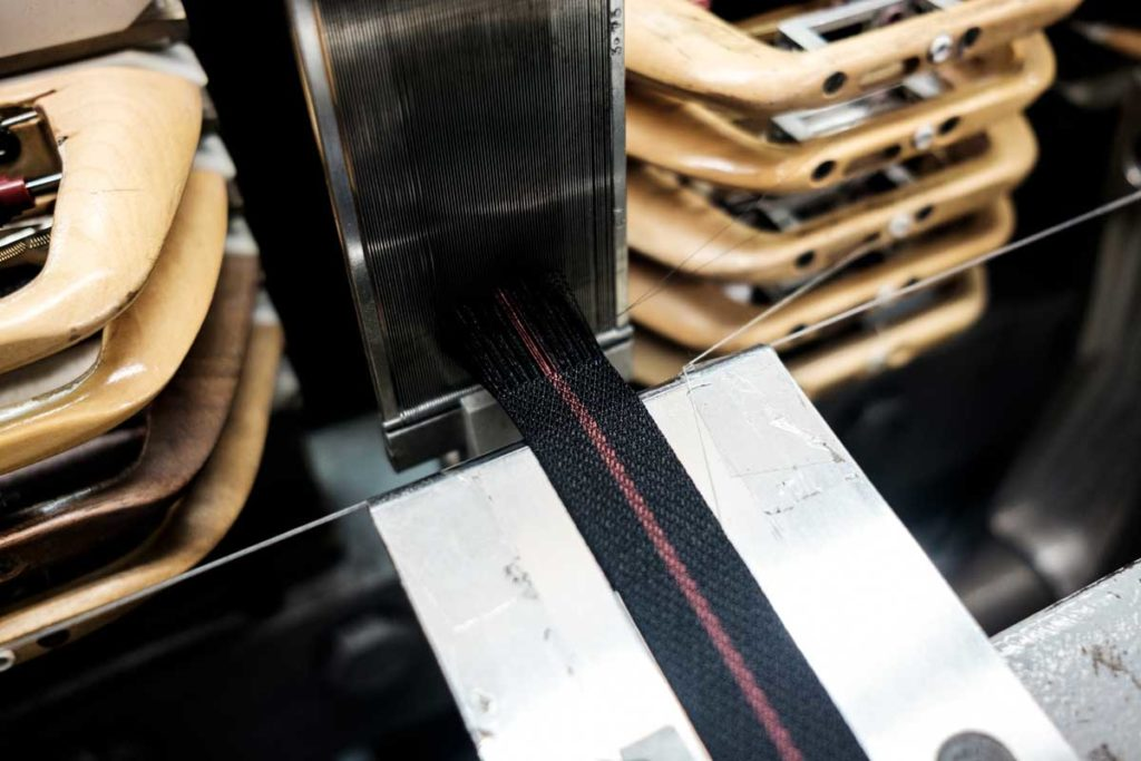 The Tudor Black Bay GMT's fabric strap being made on Julien Faure's loom machine (© Revolution)
