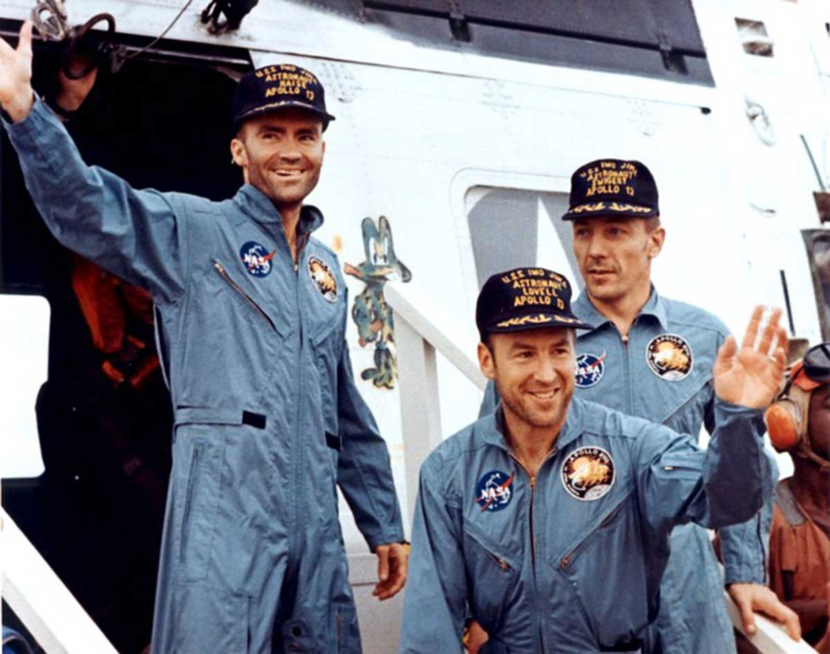 "The Apollo 13 crew — Fred Haise (left), Jim Lovell (center), and Jack Swigert — step aboard the ""USS Iwo Jima"" following splashdown and recovery operations in the south Pacific Ocean on April 17, 1970 (Image: NASA.gov)"