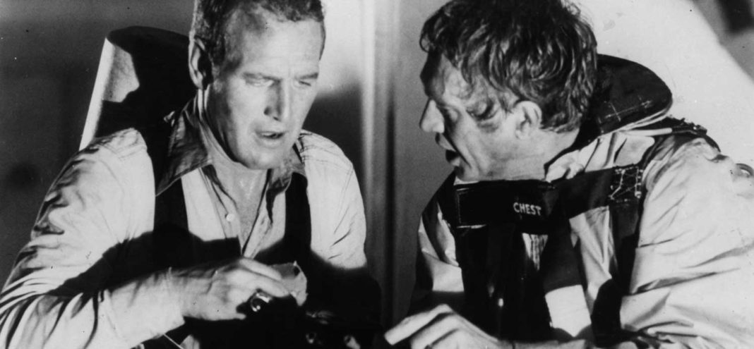 Paul Newman and Steve McQueen get ready to blow up water storage tanks in a scene from the film 'The Towering Inferno', 1974. (Photo by 20th Century-Fox/Getty Images)