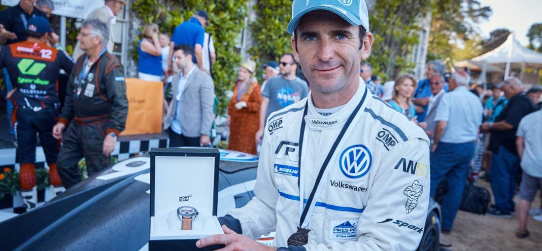 Romain Dumas of Volkswagen with the winner's Montblanc Timewalker after emerging victorious following a thrilling Top Ten Shootout, and mustering the third fastest ascent of the Hill in the Festival's 25-year history.