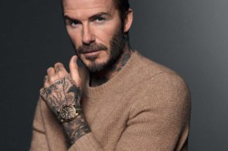 David Beckham wearing the Black Bay Bronze, photographed by David Sims, for Tudor