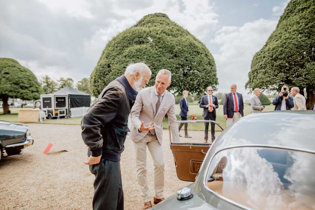 Mr Schmid with his Frazer-Nash Le Mans Coupé, speaking with Prince Michael of Kent