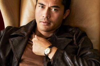 Star of Crazy Rich Asians, Henry Golding posing with his vintage Omega Seamaster De Ville on his wrist (Image: GQ.com/Brad Torchia)