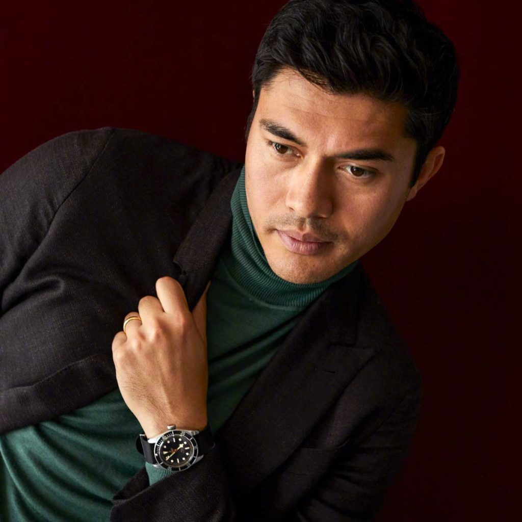 Henry Golding with his first-generation Tudor Black Bay Black on (Image: GQ.com/Brad Torchia)