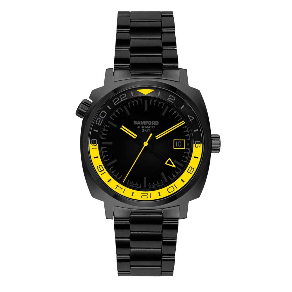 The Bamford GMT in all-black on a bracelet with yellow details and an automatic movement