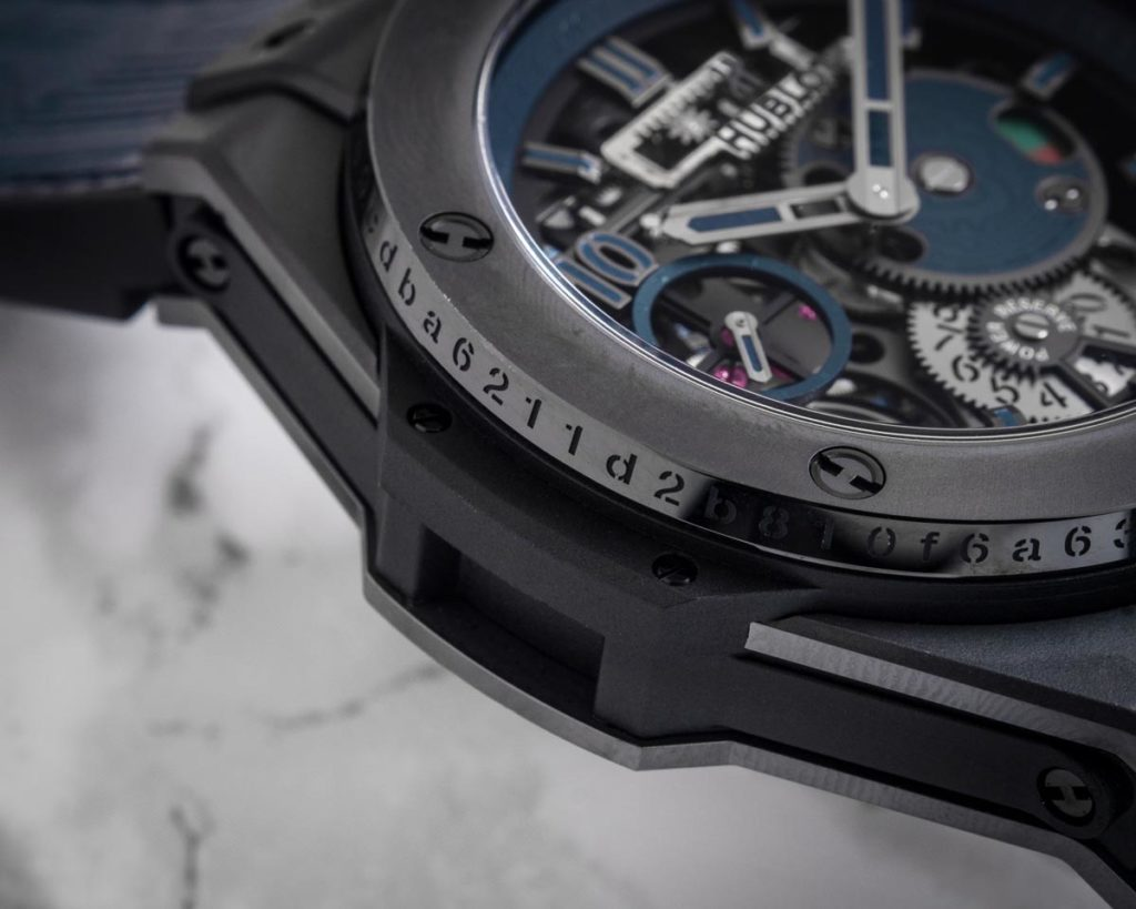 The unique identification number of the transaction made via bitcoin etched on the edge of the ceramic bezel of the Hublot Big Bang Meca-10 P2P (Image © Revolution)