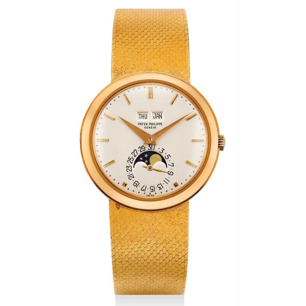 Lot 1058 at the the Phillips Hong Kong Watch Auction: SEVEN, a 1972 yellow gold ref. 3448 with a hard enamel dial and inverted date numerals around the moonphase indicator (Image: phillipswatches.com)