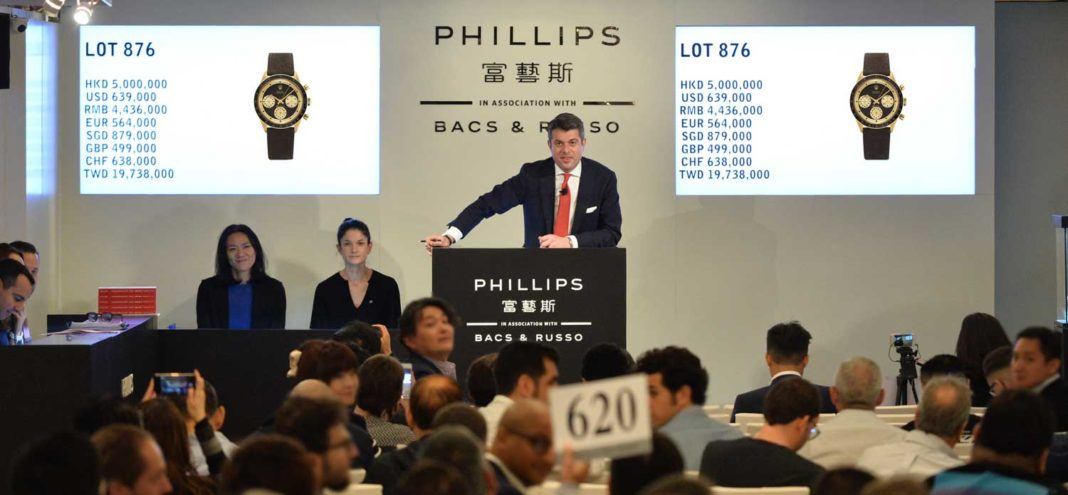 "Thomas Perazzi, Head of Watches for Phillips Asia at the auctioneer's podium moments before Lot 876 at the HKWA7, a Rolex Paul Newman Daytona Ref. 6241 ""John Player Special"" hammered for US$779,580 (all in)."