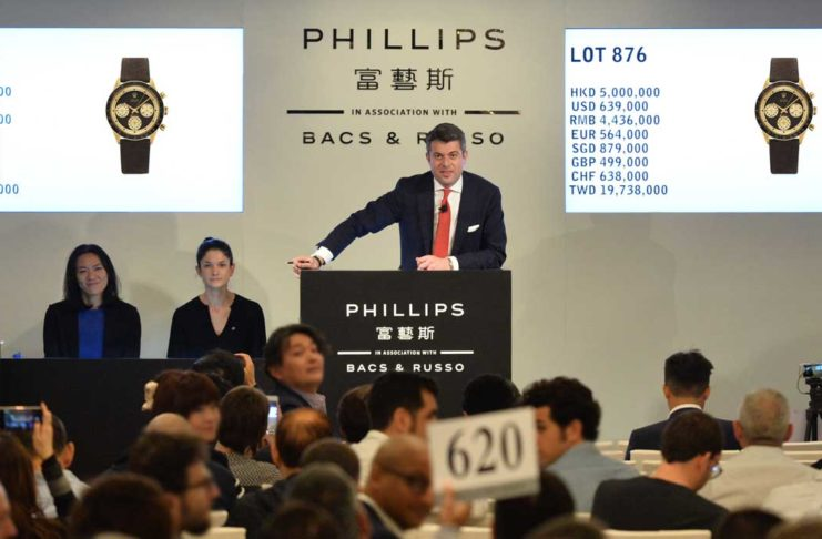 """Thomas Perazzi, Head of Watches for Phillips Asia at the auctioneer's podium moments before Lot 876 at the HKWA7, a Rolex Paul Newman Daytona Ref. 6241 """"John Player Special"""" hammered for US$779,580 (all in)."""