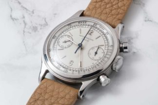 A 1946 Patek Philippe ref. 1463 in stainless steel, one of 8 known to exist in this exact execution with a two-tone silver dial (Image © Revolution)
