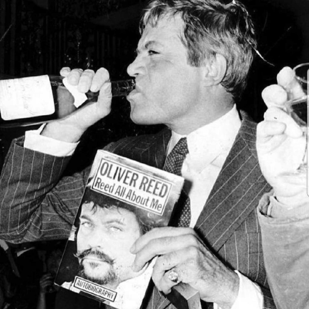 Oliver Reed promotes his 1979 autobiography in his own unique way