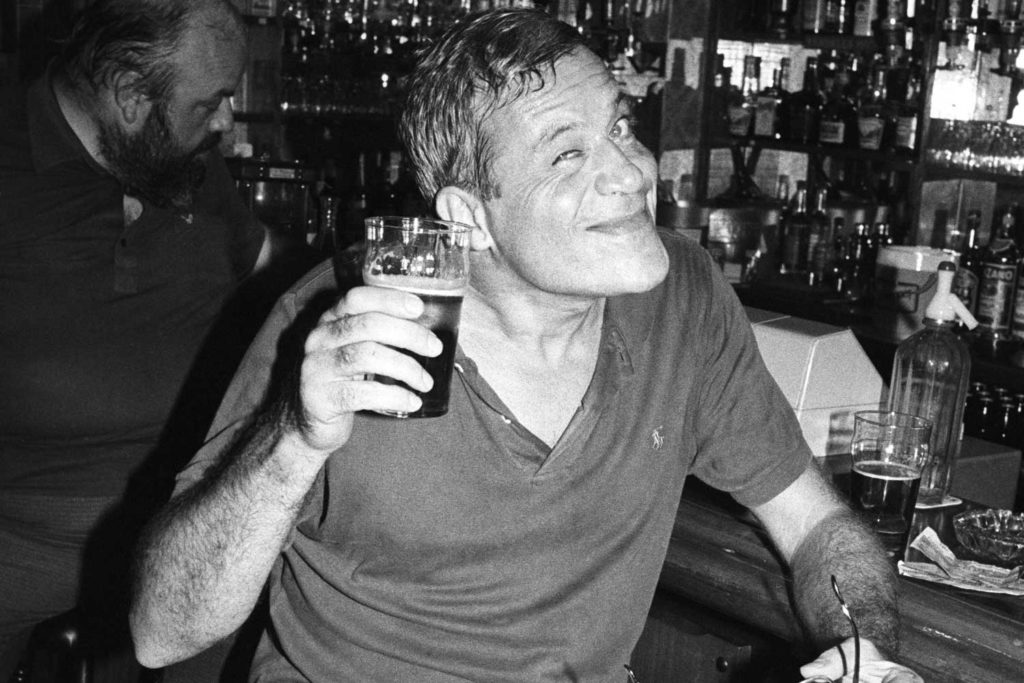 Reed enjoys a drink in 1984