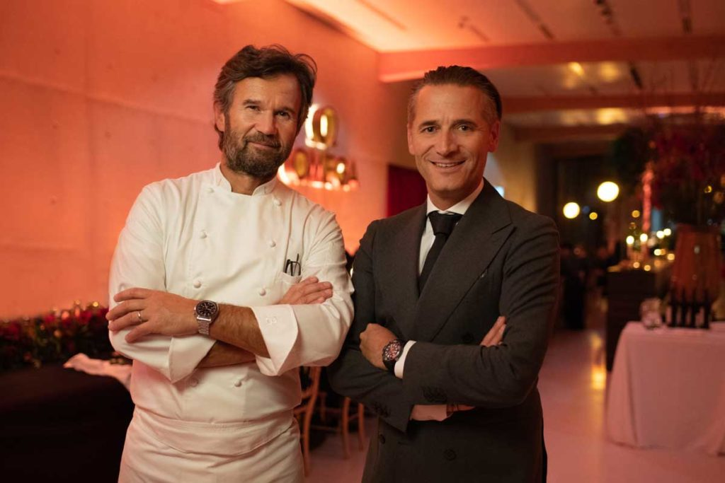Chef Carlo Cracco & President and CEO of Omega, Raynald Aeschlimann at the brand's 125th birthday at its museum in Bienne, Switzerland