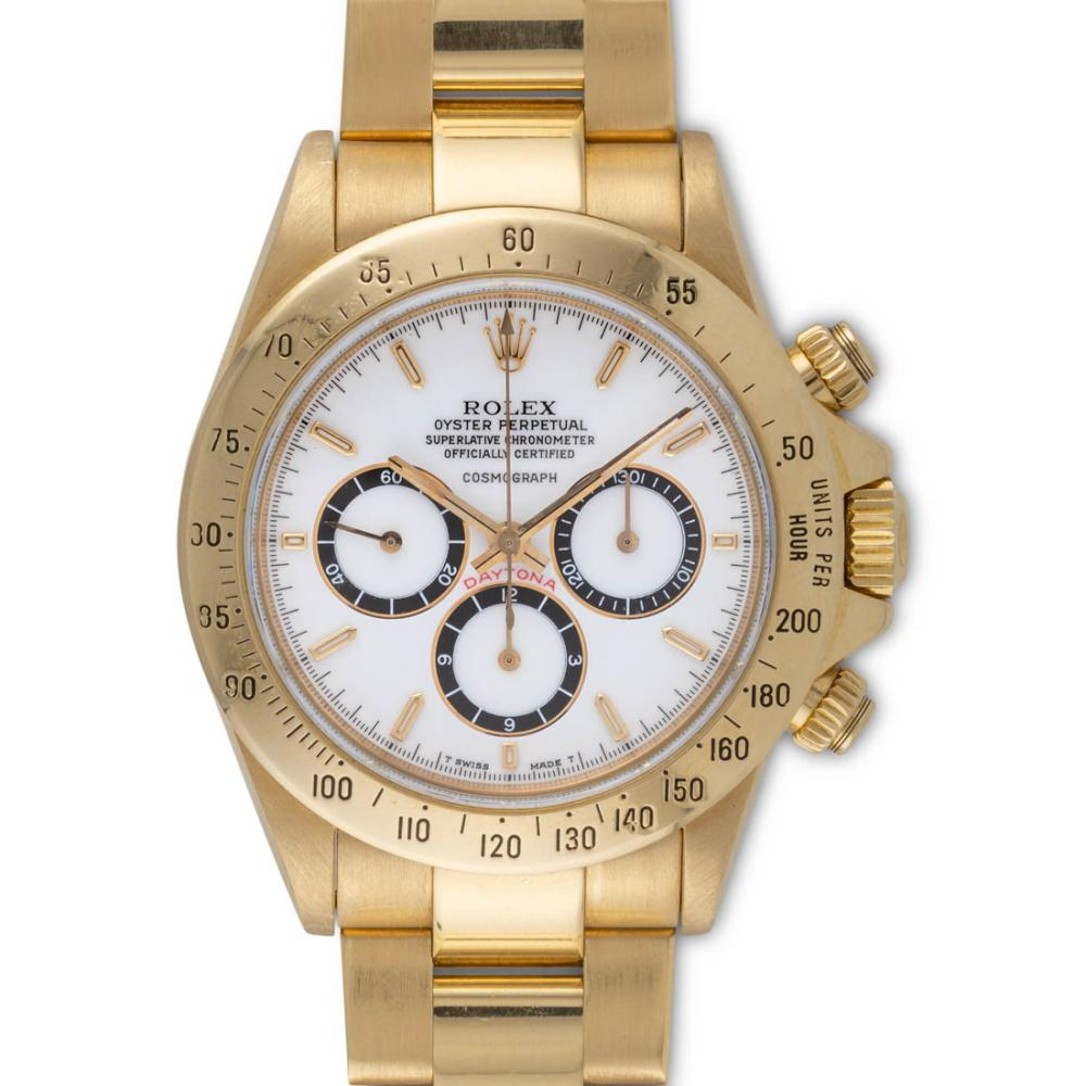 "Lot 94: Rolex – Daytona cosmograph, ref. 16528, with floating logo and ""porcelain"" dial, yellow gold, with original punched guarantee."