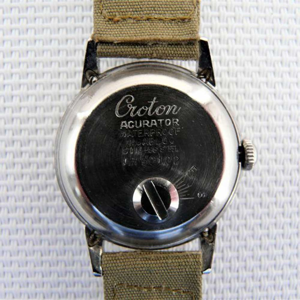 A screw on the Croton Acurator's caseback allowed rate adjustment without opening up the watch. (Image: Catawiki)