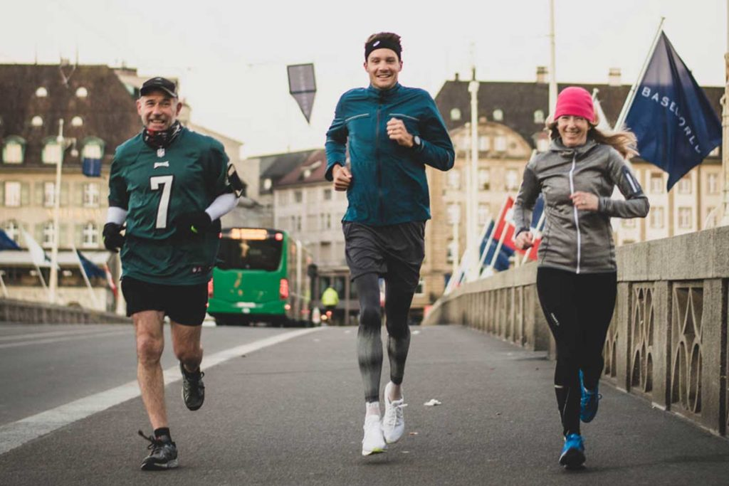 Keith W. Strandberg and Sophie Furley running with Jan Frodeno (Image © Revolution)