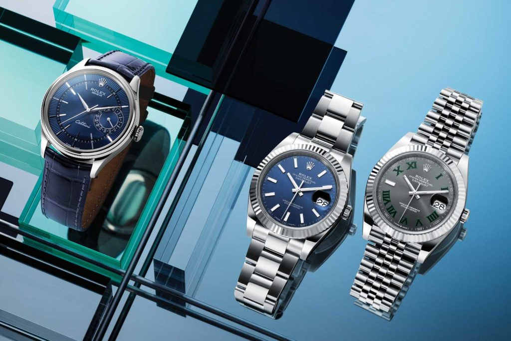 Rolex Cellini Date timepiece in white gold case with polished finish and blue leather strap (far left); Rolex Datejust 41 timepieces in Oystersteel and white gold case and Oystersteel bracelet